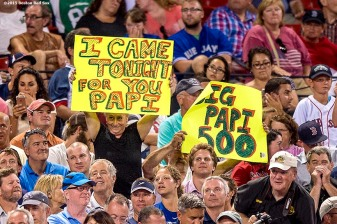 """""""Fans hold signs for David Ortiz' 500th home run during a game between the Boston Red Sox and the Toronto Blue Jays at Fenway Park in Boston, Massachusetts Monday, September 9, 2015."""""""