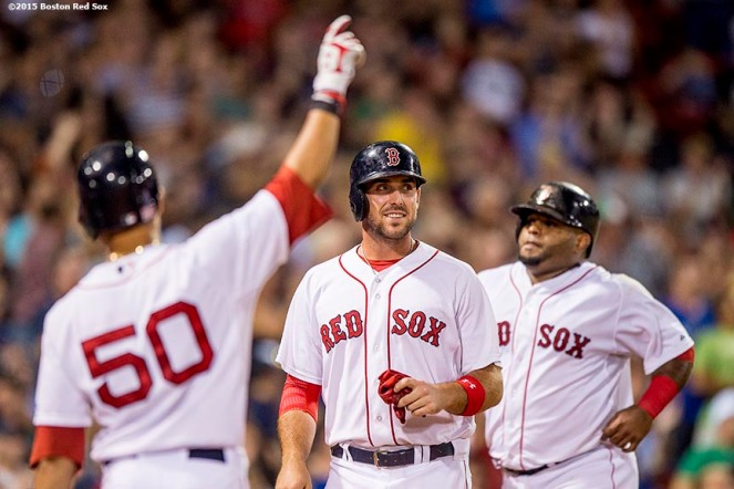 """Boston Red Sox center fielder Mookie Betts, first baseman Travis Shaw, and third baseman Pablo Sandoval react after scoring during the fifth inning of a game against the Toronto Blue Jays at Fenway Park in Boston, Massachusetts Monday, September 9, 2015."""