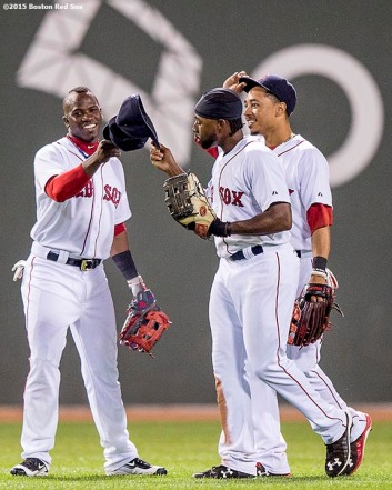 """Boston Red Sox left fielder Rusney Castillo, center fielder Mookie Betts, and right fielder Jackie Bradley Jr. react after defeating the Toronto Blue Jays at Fenway Park in Boston, Massachusetts Monday, September 9, 2015."""
