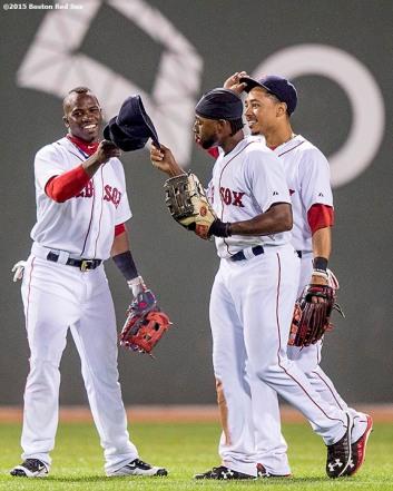 """Boston Red Sox left fielder Rusney Castillo, center fielder Mookie Betts, and right fielder Jackie Bradley Jr. react after defeating the Toronto Blue Jays at Fenway Park in Boston, Massachusetts Monday, September 9, 2015."""