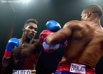 MASHANTUCKET, CT - SEPTEMBER 12: Jermall Charlo punches Cornelius Bundrage during a fight at Foxwoods Resort Casino on September 12, 2015 in Mashantucket, Connecticut. (Photo by Billie Weiss/Getty Images) *** Local Caption *** Jermall Charlo;Cornelius Bundrage