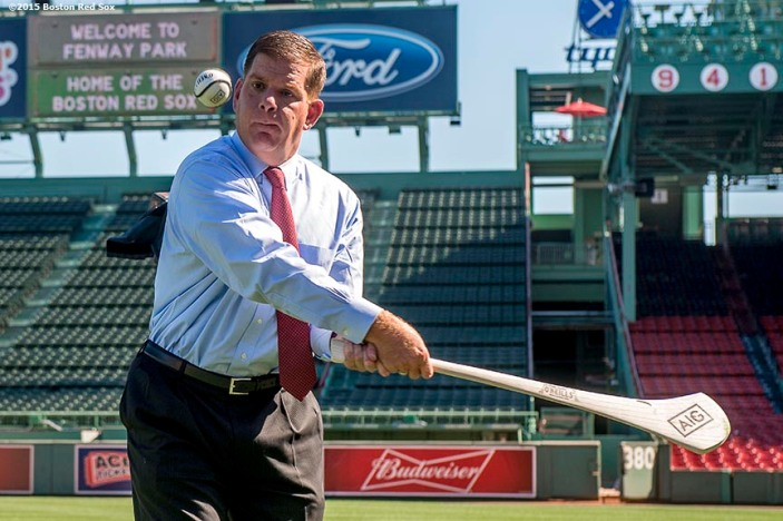 """""""Boston Mayor Martin J. Walsh practices hurling technique during a press conference announcing the AIG Fenway Hurling Classic and Irish Festival Announcement, at Fenway Park in Boston, Massachusetts Tuesday, September 15, 2015."""""""