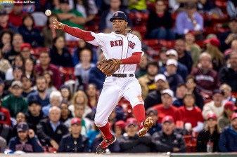 """Boston Red Sox shortstop Xander Bogaerts leaps as he throws to first base during the seventh inning of a game against the Tampa Bay Rays at Fenway Park in Boston, Massachusetts Monday, September 21, 2015."""