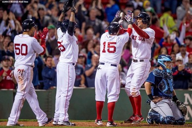 """Boston Red Sox shortstop Xander Bogaerts high five second baseman Dustin Pedroia, center fielder Jackie Bradley Jr., and right fielder Mookie Betts after hitting a go ahead grand slam during the eighth inning of a game against the Tampa Bay Rays at Fenway Park in Boston, Massachusetts Monday, September 21, 2015."""