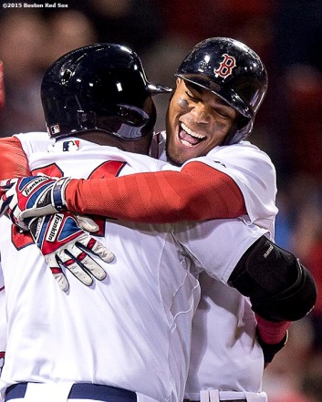 """Boston Red Sox shortstop Xander Bogaerts hugs designated hitter David Ortiz after hitting a go ahead grand slam during the eighth inning of a game against the Tampa Bay Rays at Fenway Park in Boston, Massachusetts Monday, September 21, 2015."""