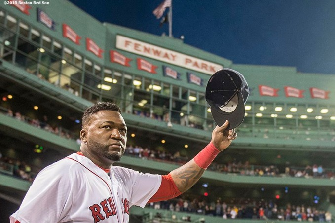 """Boston Red Sox designated hitter David Ortiz tips his cap as he is introduced during a ceremony recognizing his 500th career home run before a game against the Tampa Bay Rays at Fenway Park in Boston, Massachusetts Monday, September 21, 2015."""