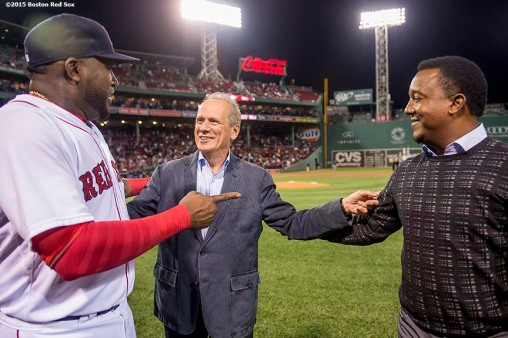 """Boston Red Sox designated hitter David Ortiz speaks with President & CEO Larry Lucchino and former pitcher Pedro Martinez during a ceremony recognizing his 500th career home run before a game against the Tampa Bay Rays at Fenway Park in Boston, Massachusetts Monday, September 21, 2015."""