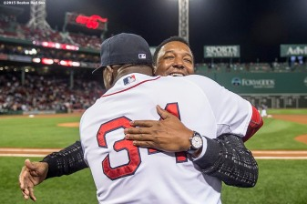 """Boston Red Sox designated hitter David Ortiz hugs former pitcher Pedro Martinez during a ceremony recognizing his 500th career home run before a game against the Tampa Bay Rays at Fenway Park in Boston, Massachusetts Monday, September 21, 2015."""