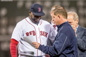 """Boston Red Sox designated hitter David Ortiz hugs Boston Mayor Marty Walsh as he declares 'David Ortiz Day' in Boston during a ceremony recognizing his 500th career home run before a game against the Tampa Bay Rays at Fenway Park in Boston, Massachusetts Monday, September 21, 2015."""