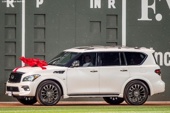"""Boston Red Sox designated hitter David Ortiz is presented with an Infiniti car during a ceremony recognizing his 500th career home run before a game against the Tampa Bay Rays at Fenway Park in Boston, Massachusetts Monday, September 21, 2015."""