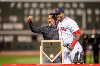 """Former Boston Red Sox pitcher Pedro Martinez and Boston Red Sox designated hitter David Ortiz react during a ceremony recognizing his 500th career home run before a game against the Tampa Bay Rays at Fenway Park in Boston, Massachusetts Monday, September 21, 2015."""