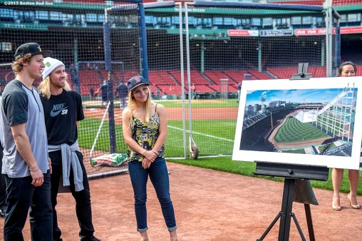 """Olympic skiing gold medalist Joss Christensen, Olympic snowboarding gold medalist Sage Kotsenburg, and snowboarder Ty Walker look on as a rendering is unveiled during a press conference announcing a Big Air ski and snowboard competition at Fenway Park in Boston, Massachusetts Tuesday, September 22, 2015."""