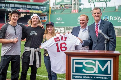 """Boston Red Sox Chief Operating Officer Sam Kennedy presents Olympic skiing gold medalist Joss Christensen, Olympic snowboarding gold medalist Sage Kotsenburg, snowboarder Ty Walker, and USSA CMO Michael Jaquet with a jersey during a press conference announcing a Big Air ski and snowboard competition at Fenway Park in Boston, Massachusetts Tuesday, September 22, 2015."""