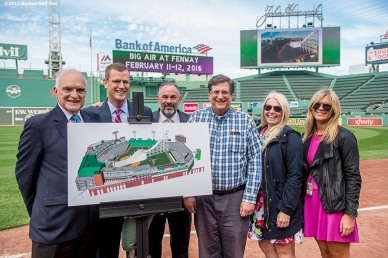 """Director of the Boston Convention and Visitors Bureau Pat Mascoritolo, Boston Red Sox Chief Executive Officer Sam Kennedy, Boston Director of Tourism for Sports and Entertainment Ken Brissette, and Larry Cancro, Beth Krudys, and Greta Buerman of Fenway Affairs pose for a photograph during a press conference announcing a Big Air ski and snowboard competition at Fenway Park in Boston, Massachusetts Tuesday, September 22, 2015."""