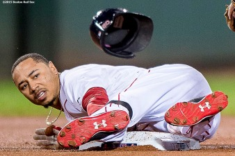 """Boston Red Sox right fielder Mookie Betts slides into second base after hitting a double during the first inning of a game against the Tampa Bay Rays at Fenway Park in Boston, Massachusetts Tuesday, September 22, 2015."""