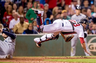 """Boston Red Sox catcher Blake Swihart falls as he throws to first to complete a double play during the seventh inning of a game against the Tampa Bay Rays at Fenway Park in Boston, Massachusetts Tuesday, September 22, 2015."""