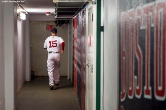 """Boston Red Sox second baseman Dustin Pedroia runs through the tunnel before a game between the Boston Red Sox and the Tampa Bay Rays at Fenway Park in Boston, Massachusetts Tuesday, September 22, 2015."""