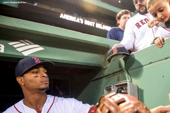 """Shortstop Xander Bogaerts signs autographs before a game between the Boston Red Sox and the Tampa Bay Rays at Fenway Park in Boston, Massachusetts Tuesday, September 22, 2015."""