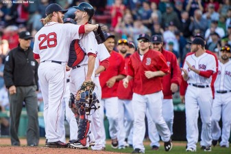 """Boston Red Sox pitcher Robbie Ross Jr. and catcher Blake Swihart hug after defeating the Baltimore Orioles at Fenway Park in Boston, Massachusetts Sunday, September 27, 2015."""