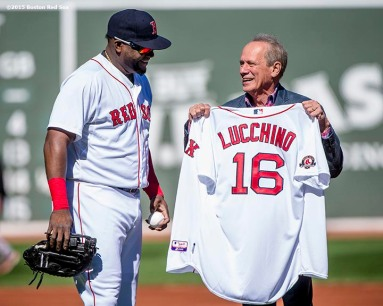 """Boston Red Sox President & CEO Larry Lucchino is presented with a jersey commemorating him as a member of the Boston Red Sox hall of fame by designated hitter David Ortiz during a tribute ceremony for him before a game between the Boston Red Sox and the Baltimore Orioles at Fenway Park in Boston, Massachusetts Sunday, September 27, 2015."""
