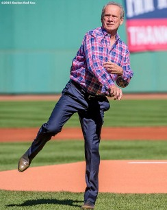 """Boston Red Sox President & CEO Larry Lucchino throws out a ceremonial first pitch during a tribute ceremony for him before a game between the Boston Red Sox and the Baltimore Orioles at Fenway Park in Boston, Massachusetts Sunday, September 27, 2015."""