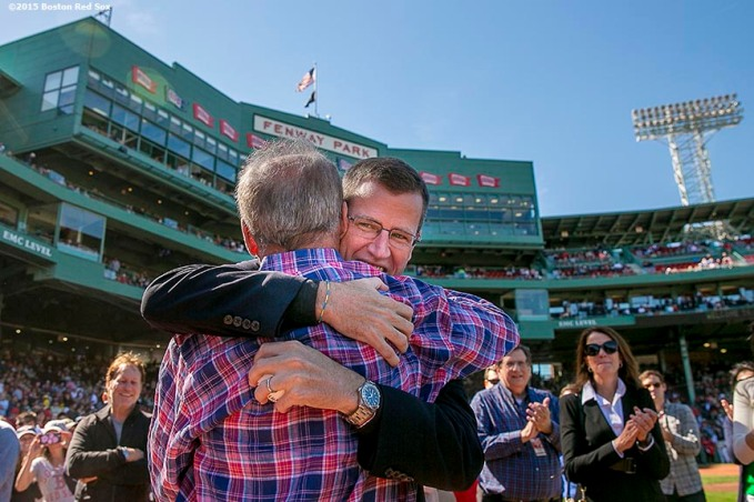 """Boston Red Sox President & CEO Larry Lucchino is congratulated by Chief Operating Officer Sam Kennedy during a tribute ceremony for Larry Lucchino before a game between the Boston Red Sox and the Baltimore Orioles at Fenway Park in Boston, Massachusetts Sunday, September 27, 2015."""