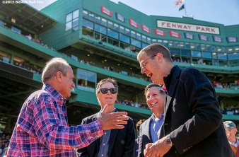 """Boston Red Sox President & CEO Larry Lucchino, Principal Owner John Henry, Chairman Tom Werner, and Chief Operating Officer Sam Kennedy talk during a tribute ceremony for Larry Lucchino before a game between the Boston Red Sox and the Baltimore Orioles at Fenway Park in Boston, Massachusetts Sunday, September 27, 2015."""