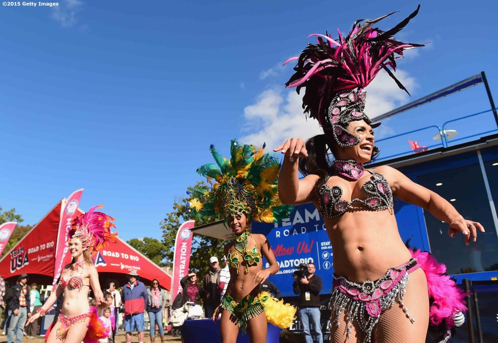 BOSTON, MA - OCTOBER 17: Samba dancers perform during a Road to Rio Tour presented by Liberty Mutual Insurance event on October 17, 2015 at the Head of the Charles Regatta in Boston, Massachusetts. (Photo by Billie Weiss/Getty Images for the USOC)