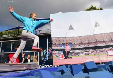 BOSTON, MA - OCTOBER 17: A fan participates in a long jump game during a Road to Rio Tour presented by Liberty Mutual Insurance event on October 17, 2015 at the Head of the Charles Regatta in Boston, Massachusetts. (Photo by Billie Weiss/Getty Images for the USOC)