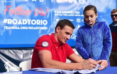 BOSTON, MA - OCTOBER 17: US Olympian Ryan Lochte signs autographs during a Road to Rio Tour presented by Liberty Mutual Insurance event on October 17, 2015 at the Head of the Charles Regatta in Boston, Massachusetts. (Photo by Billie Weiss/Getty Images for the USOC)