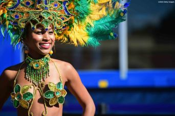 BOSTON, MA - OCTOBER 17: A samba dancer performs during a Road to Rio Tour presented by Liberty Mutual Insurance event on October 17, 2015 at the Head of the Charles Regatta in Boston, Massachusetts. (Photo by Billie Weiss/Getty Images for the USOC)
