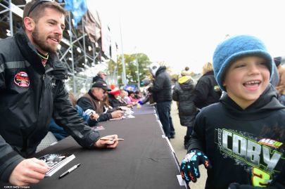 THOMPSON, CT - OCTOBER 18: Doug Coby signs autographs during the NASCAR Whelen Modified Tour SUNOCO World Series 150 at Thompson Speedway on October 18, 2015 in Thompson, Connecticut. (Photo by Billie Weiss/NASCAR/NASCAR via Getty Images)
