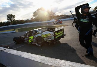 THOMPSON, CT - OCTOBER 18: The pit crew works on the car of Doub Coby #2 during the NASCAR Whelen Modified Tour SUNOCO World Series 150 at Thompson Speedway on October 18, 2015 in Thompson, Connecticut. (Photo by Billie Weiss/NASCAR/NASCAR via Getty Images)
