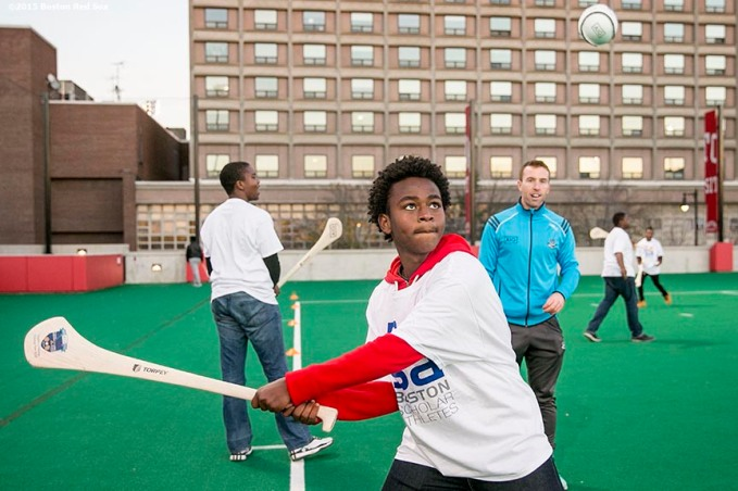 """A Boston Scholar Athlete participates in a hurling clinic at New Balance Field at Boston University in Boston, Massachusetts ahead of the AIG Fenway Hurling Classic and Irish Festival Tuesday, November 17, 2015."""