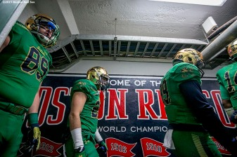 """Members of Notre Dame walk through the tunnel during the Shamrock Series Football at Fenway game against Boston College at Fenway Park in Boston, Massachusetts Saturday, November 21, 2015."""