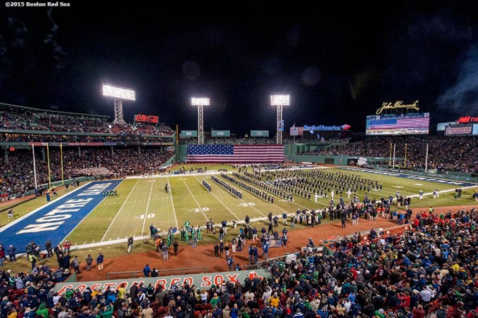 """The American flag is dropped over the Green Monster as the Notre Dame marching band performs during the Shamrock Series Football at Fenway game against Boston College at Fenway Park in Boston, Massachusetts Saturday, November 21, 2015."""