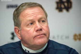 """Notre Dame head coach Brian Kelly addresses the media during a press conference after the Shamrock Series Football at Fenway game against Boston College at Fenway Park in Boston, Massachusetts Saturday, November 21, 2015."""