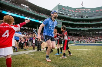 """A member of Dublin takes the field during the AIG Hurling Classic and Irish Festival game against Galway at Fenway Park in Boston, Massachusetts Saturday, November 22, 2015."""