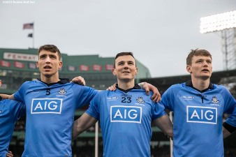 """Members of Dublin look on during the National Anthem before playing Galway at the AIG Hurling Classic and Irish Festival at Fenway Park in Boston, Massachusetts Saturday, November 22, 2015."""