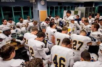 """Members of the Xaverian Brothers High School football team sit in the locker room before a game against St. John's Preparatory School at Fenway Park in Boston, Massachusetts Wednesday, November 25, 2015."""