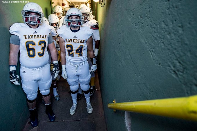 """Members of the Xaverian Brothers High School football team wait in the tunnel before a game against St. John's Preparatory School at Fenway Park in Boston, Massachusetts Wednesday, November 25, 2015."""