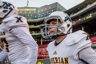 """Members of the Xaverian Brothers High School football team take the field before a game against St. John's Preparatory School at Fenway Park in Boston, Massachusetts Wednesday, November 25, 2015."""
