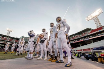 """Members of the Xaverian Brothers High School football team look on before a game against St. John's Preparatory School at Fenway Park in Boston, Massachusetts Wednesday, November 25, 2015."""