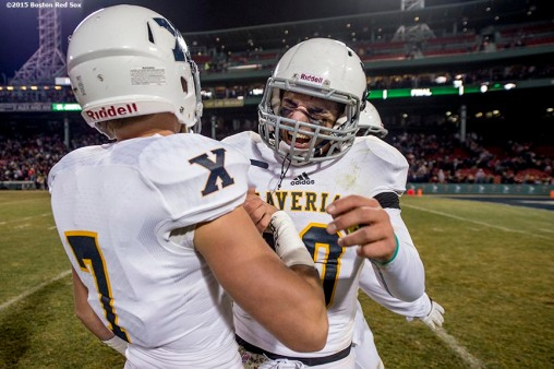 """Members of the Xaverian Brothers High School football team react after defeating St. John's Preparatory School at Fenway Park in Boston, Massachusetts Wednesday, November 25, 2015."""