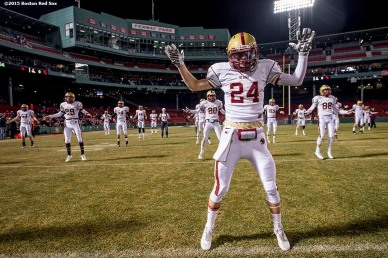 """""""Members of the Xaverian Brothers High School football team warm up before a game against St. John's Preparatory School at Fenway Park in Boston, Massachusetts Wednesday, November 25, 2015."""""""