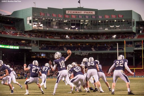 """Game action during a high school football game between Xaverian Brothers High School and St. John's Preparatory School at Fenway Park in Boston, Massachusetts Wednesday, November 25, 2015."""