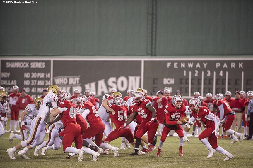 """Game action during a high school football game between Boston College High School and Catholic Memorial High School at Fenway Park in Boston, Massachusetts Wednesday, November 25, 2015."""