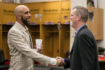 """Boston Red Sox President Sam Kennedy greets pitcher David Press in the clubhouse before a press conference announcing a seven year contract to the Boston Red Sox at Fenway Park in Boston, Massachusetts Friday, December 4, 2015."""