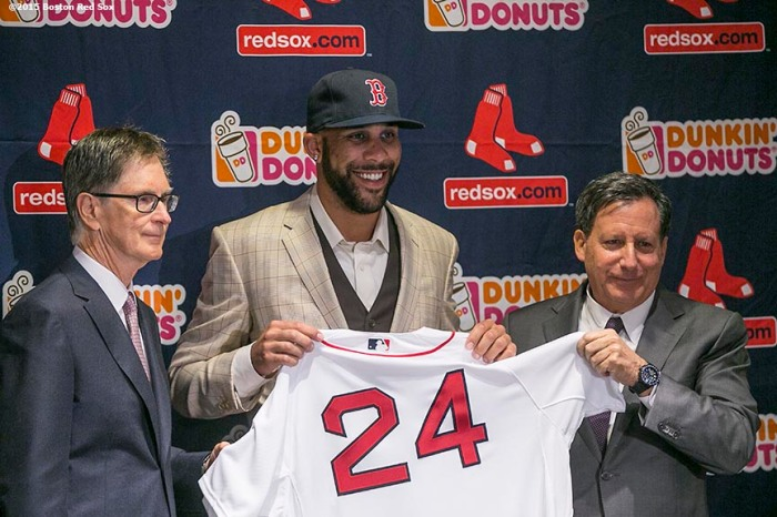 """Principal Owner John Henry and Chairman Tom Werner present pitcher David Price with a jersey during a press conference after agreeing to a seven year contract with the Boston Red Sox at Fenway Park in Boston, Massachusetts Friday, December 4, 2015."""