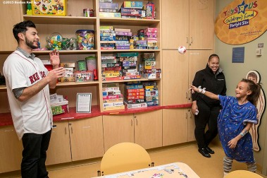 """Boston Red Sox pitcher Noe Ramirez plays catch with a patient at Massachusetts General Hospital during the Holiday Caravan in Boston, Massachusetts Friday, December 10, 2015."""